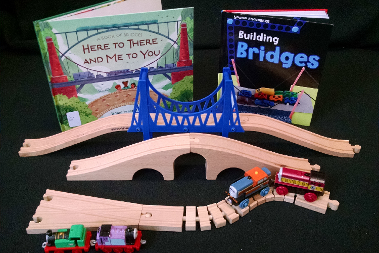 Photo of toy bridges, toy trains, and books about bridges
