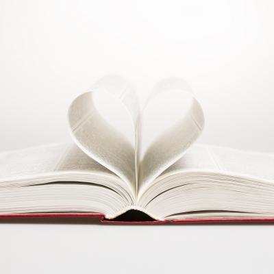 Book with pages curled into a heart shape