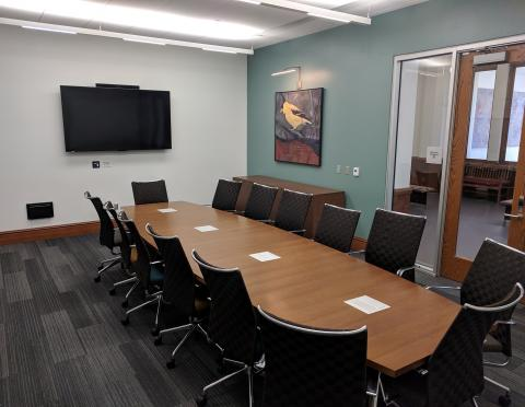 Dale H. Ross Boardroom with boardroom style seating and mounted tv screen