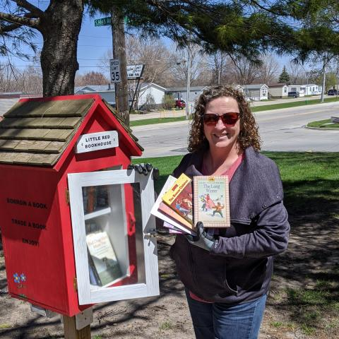 Sarah Refilling Little Free Library