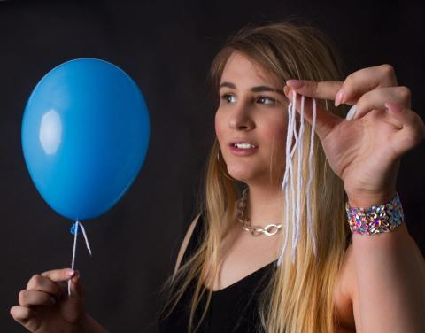 Magic Mikayla holding balloon and string