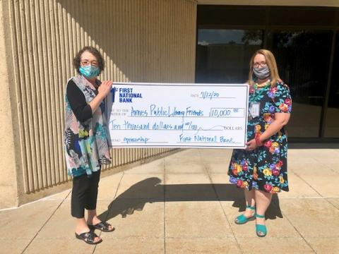 First National Bank, Ames, presents $10,000 check to Ames Public Library Friends Foundation